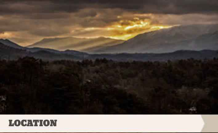 "A stunning sunset photo of the Smoky Mountains with the text ""location""."