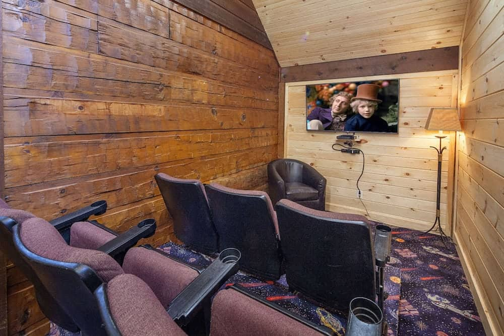 A cabin with a theater room in Pigeon Forge.